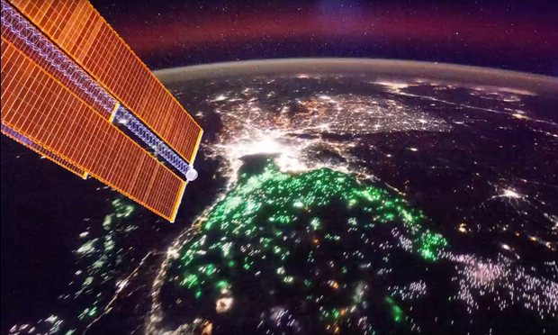 Green spots seen from the International Space Station are the lights of fishing boats used to attract squid across the Gulf of Thailand. Photograph: ISS/Nasa